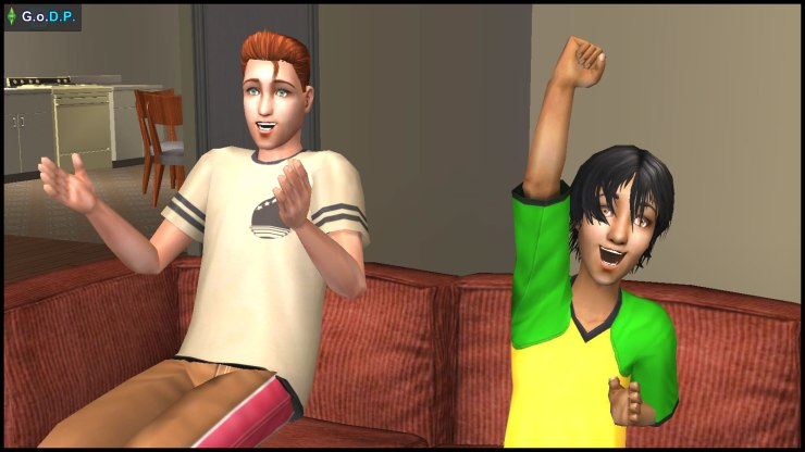 Young Daniel & Jennifer Pleasant cheer while watching football on TV