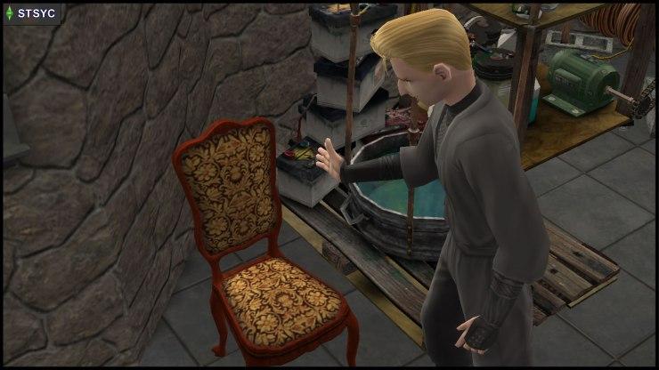 Loki Beaker grabs a chair