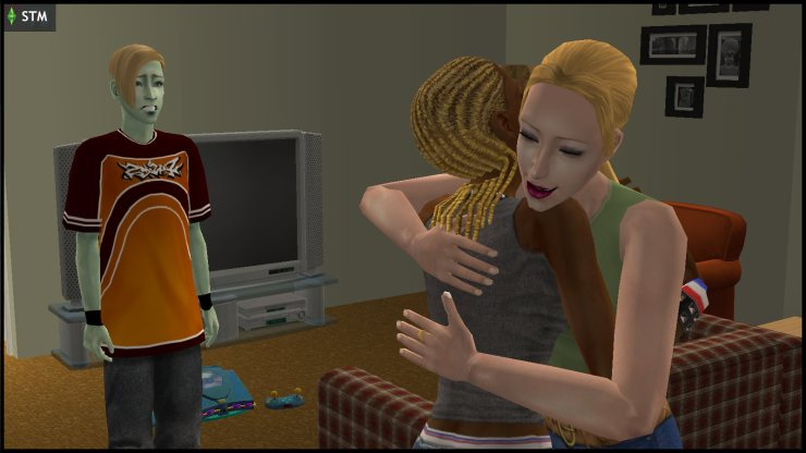 Jenny Smith gives a maternal hug to Ophelia Nigmos, as Johnny Smith worries about her